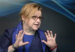 Corina Suteu, the new Romanian Culture Minister gestures during a press conference in Bucharest, Romania, Thursday, May 5, 2016